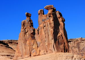 Gossips in Splendor (Utah) - The Three Gossips in Arches National Park near Moab, Utah is one of the most unusual rock formations in the world. The three tower some 350 feet.